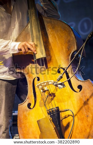 Abstract jazz music. Bass musician on stage - stock photo
