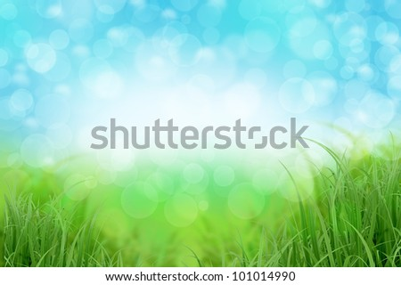 Abstract landscape background with green grass and blue sky