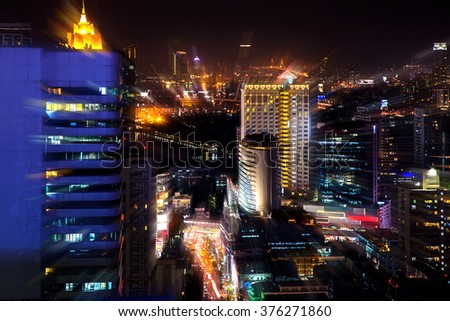 Abstract light background of city, building, road and street in the night. moving camera zoom shot.