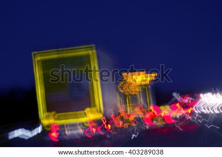 Abstract light on busy road in night, England. - stock photo