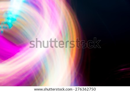 Abstract Light painting, Colorful tone on black background -  long exposure time lapse technique and blurred picture style - stock photo