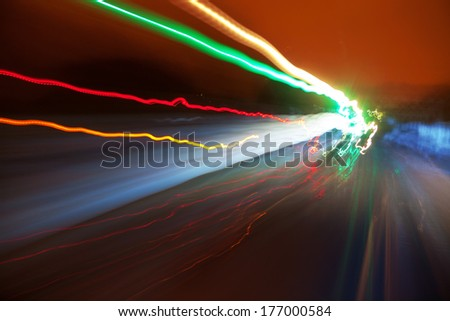 Abstract light trails on the railway - stock photo