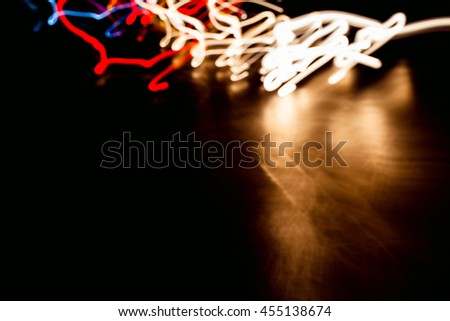 Abstract lights created by lights on railway track