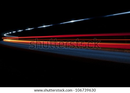 Abstract lights from an ambulance in a road tunnel - stock photo