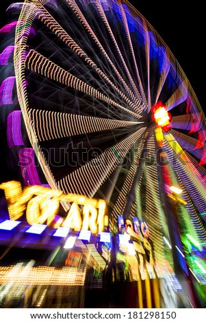 Abstract long exposure picture of highlighted giant ferris wheel in Prater Amusement Park in Vienna. - stock photo
