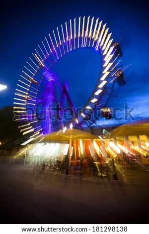 Abstract long exposure picture of oldest, historic ferris wheel in Prater Amusement Park in Vienna. - stock photo