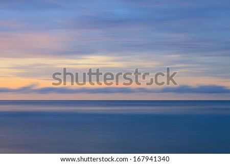 Abstract long exposure shot of sunset - stock photo