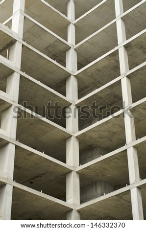 Abstract looking apartment building that was abandoned halfway through construction - stock photo