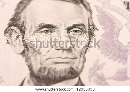 Abstract Macro of U.S. Five Dollar Bill's Abraham Lincoln face with Narrow Depth of Field.