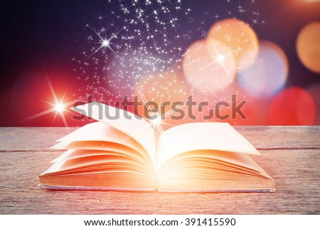 Abstract magic book on wooden background
