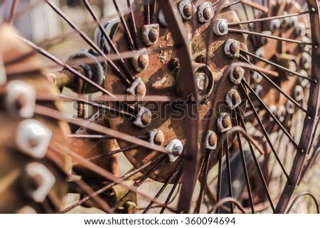 Abstract metal lines from a farm windrow equipment. Agricultural machinery. Small depth of field