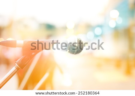 abstract microphone on street in the city, pastel and blur concept - stock photo
