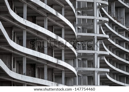 Abstract modern architecture fragment with concrete floors and walls under construction - stock photo