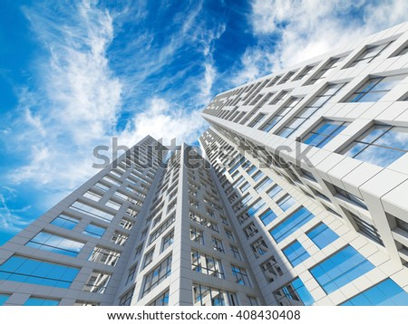Abstract modern architecture. Perspective of tall city towers under blue cloudy sky. 3d render illustration - stock photo
