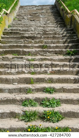 Abstract modern concrete stairs to building - stairway composition / stairs going up to the light / Empty white stairs in pedestrian subway with dull sky - stock photo