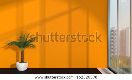 abstract modern interior with palm, orange wall and sunlight - stock photo