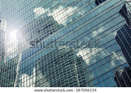 Abstract modern skyscraper construction, Windows with reflection building facade architecture - stock photo