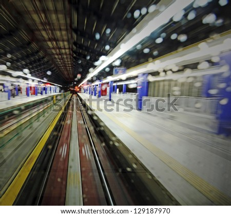 Abstract motion blur at an urban underground train station. - stock photo