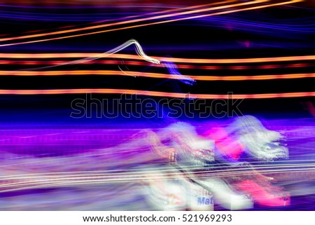 Abstract motion blur messy light trail.Night lights at city.For abstract background.Painting with light using the multicolored bulb Christmas - Light painting