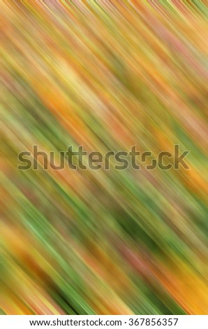 Abstract motion blur, mostly shades of orange, for decoration and backgrounds