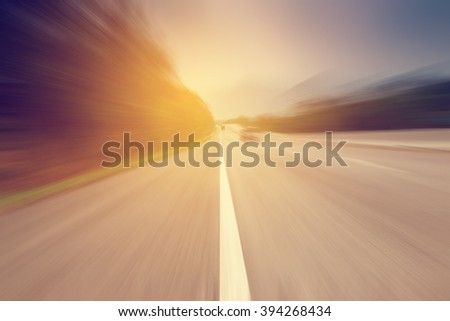 Abstract motion blurred road and sunlight with vintage tone. - stock photo