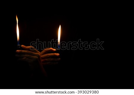 abstract Motion Hand with lighter igniting sparks on dark background