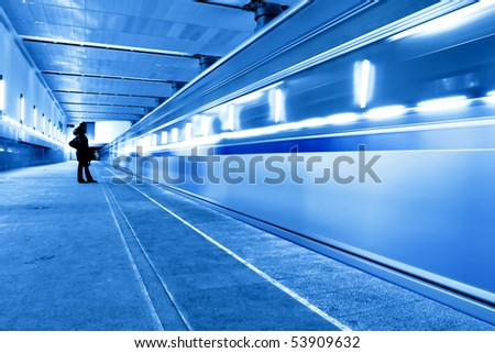 abstract moving train in blue corridor - stock photo