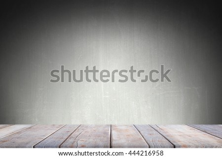 Abstract Natural wood table with blurred photo backdrop concrete grunge background. Top view of plank wood for graphic stand product, interior design or montage display your product  - stock photo