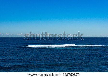 Abstract nature background of clear blue sky and calm sea with distant wave. Australia, Pacific ocean - stock photo