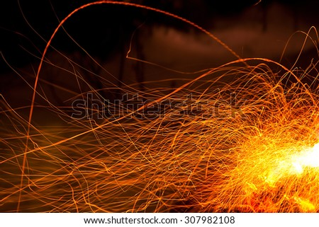 Abstract nature: long exposure photo of fire camp sparkles - stock photo
