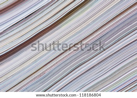 Abstract newspaper background made from a stock of magazines