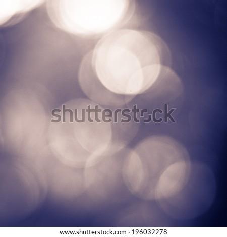 Abstract of black bokeh defocused lights - stock photo
