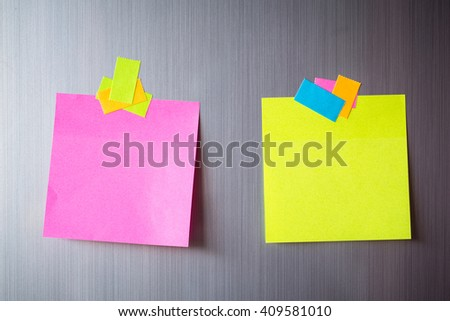 Abstract of Blank paper and stick paper on refrigerator door. paper note copy space for add text. - stock photo