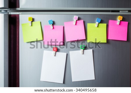 Abstract of Blank paper and sticker note on refrigerator door. - stock photo