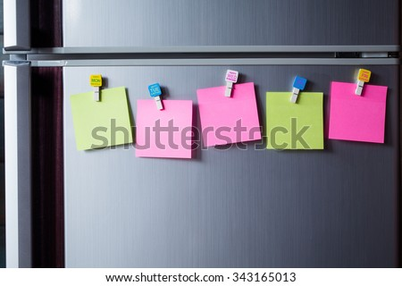 Abstract of Blank paper and sticker note on refrigerator door.