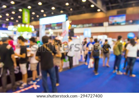 Abstract of blurred people walking in shopping centre. - stock photo