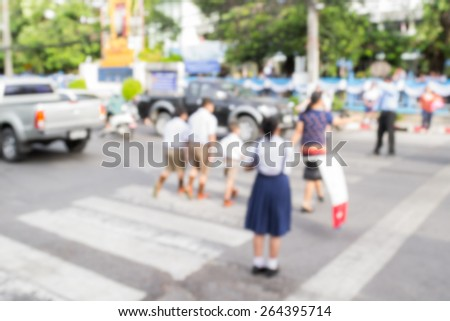 Abstract of blurred schoolchild walk crossing the street