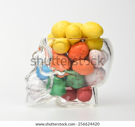 abstract of chocolate and crystal skull glass shot like a brain isolated dicut with clipping path - stock photo