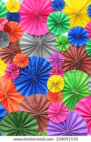abstract of colorful paper fan for background - stock photo