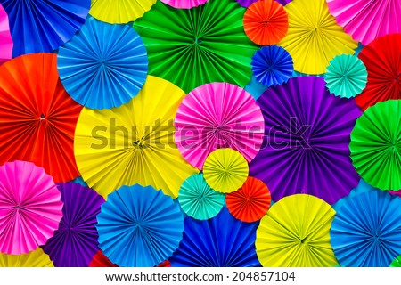 Abstract  of colorful paper filigree strips folded in waves - stock photo