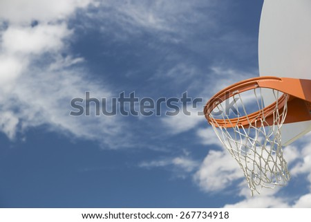 Abstract of Community Basketball Hoop and Net Against Blue Sky. - stock photo