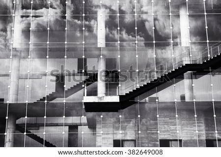 Abstract of exterior building with ladder and cloud reflection in mirror glass - stock photo