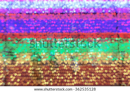 Abstract of multi-color Bokeh in Red, Magenta Pink, Purple, Green, Red and Yellow Christmas Lights Decoration, defocused, for wallpaper and background - stock photo