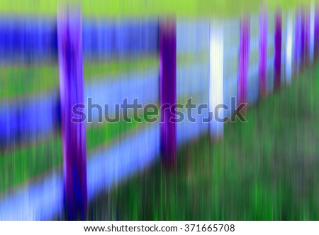 Abstract of paddock fence with vertical motion blur and surreal coloration, for illustration or background with motifs of rusticness, dreams, memories - stock photo