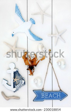 Abstract of seaside symbols with beach sign over wooden white background. - stock photo