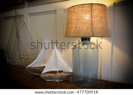 Abstract of several types of model sailboats and glass lamp
