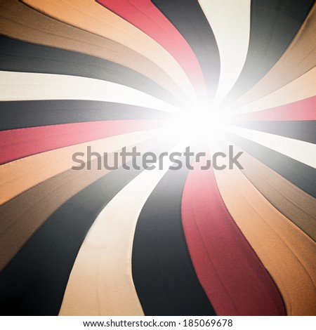 Abstract old grunge background texture of perspective intersection with vintage color curve and radial red, yellow, brown, white and black lines in fabric, cloth wallpaper shining light, retro pattern - stock photo
