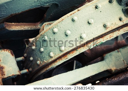 Abstract old industrial mechanism details assembly, selective focus and shallow DOF, vintage toned photo with old style filter effect - stock photo