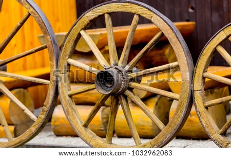 abstract old wooden wheels closeup photo