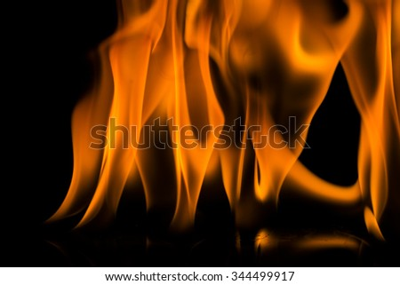 Abstract orange and black fire flames on a black background